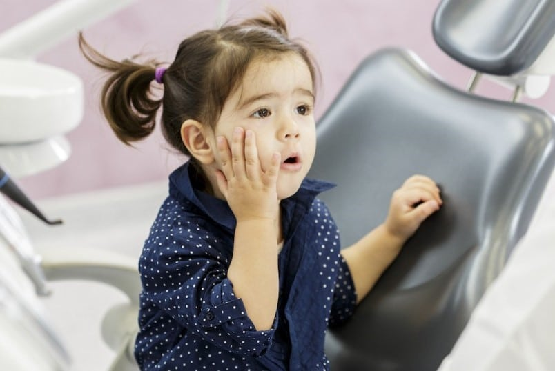 child with toothache because of cavity
