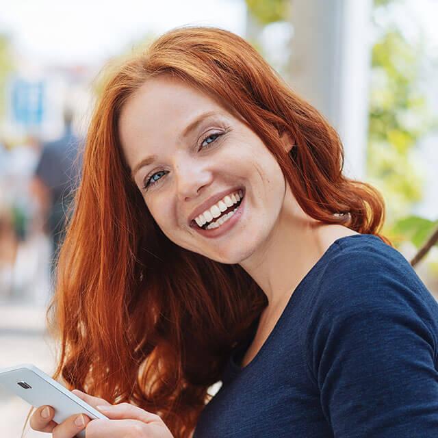 women smiling showing her beautiful smile